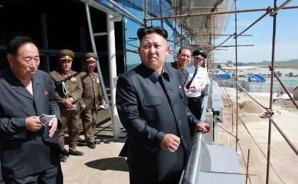 Kim Jon Un at a construction site within the Pyongyang Airport.