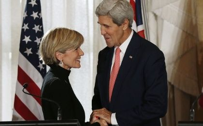 Australian Foreign Minister Julie Bishop and U.S. Secretary of State John Kerry shake hands at the end of their joint news conference in Sydney August 12, 2014. (Photo: Reuters)