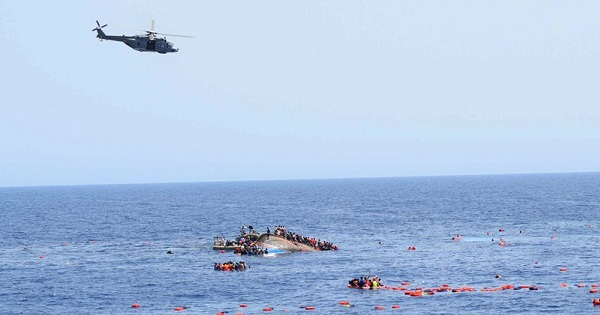 Italian navy ships rescue people from the overturned boat