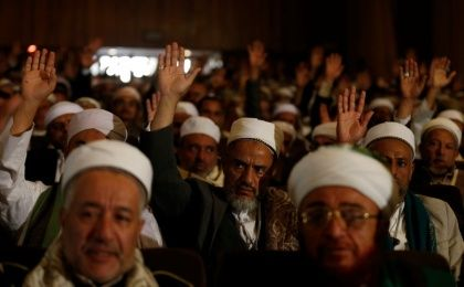 Religious scholars supporting the Houthi movement raise their hands as they attend a meeting in Sanaa, Yemen, May 18, 2016.