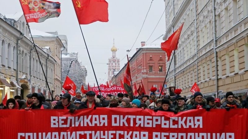 To this day, the October Revolution continues to be celebrated. Here, Russian communist supporters carry a banner reading