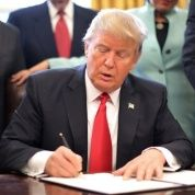 U.S. President Donald Trump signs an executive order cutting regulations at the Oval Office of the White House in Washington, Jan. 30, 2017.