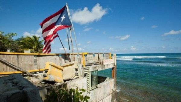 Puerto Rico And US Flags Flutter On A Building That Once Belonged To Restaurant