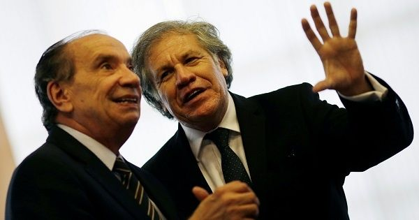 OAS Secretary-General Luis Almagro (R) speaks with Brazil