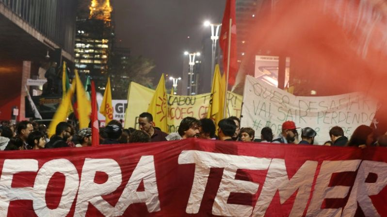 Demonstrators attend a protest against Brazil