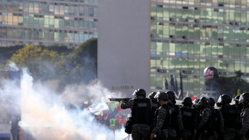Riot police officers clash with demonstrators during a protest against President Michel Temer and the latest corruption scandal to hit the country, in Brasilia.