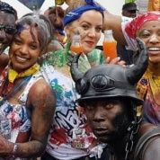 People taking part in Jourvay celebrations for Notting Hill Carnival 2017.