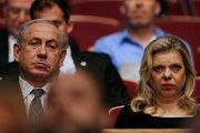 Israeli Prime Minister Benjamin Netanyahu (R) with his wife Sara Netanyahu (L) are both in legal heat for alleged fraud.