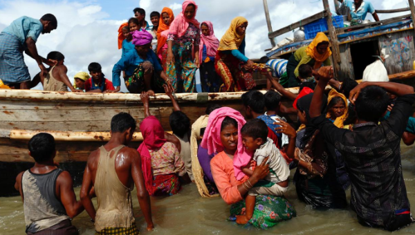 Rohingya refugees arrive after crossing the Bangladesh-Myanmar border through the Bay of Bengal, Bangladesh, September 11, 2017.