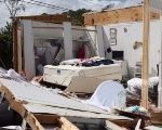 A destroyed bedroom in a mobile house in Naples, Florida.