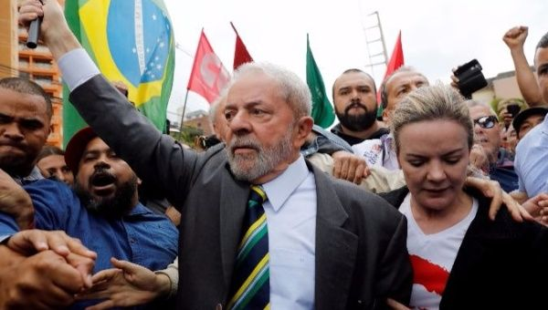 Lula arrives in court to testify before Judge Sergio Moro in May.