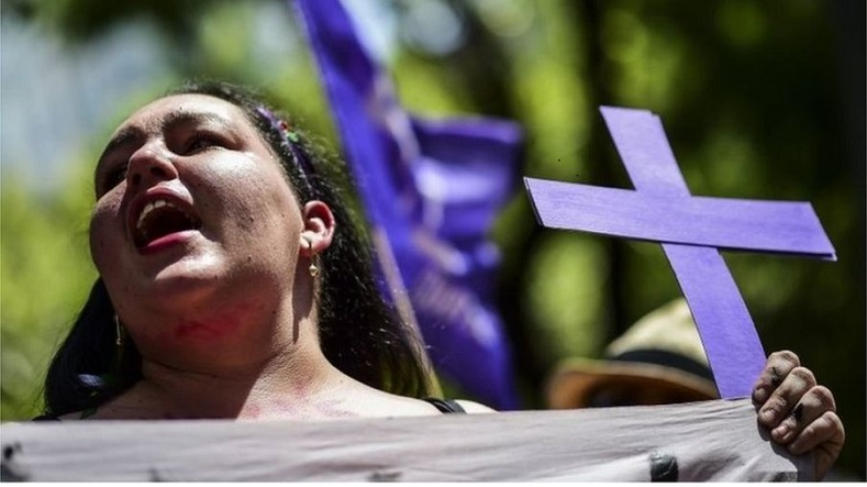 A woman protests against femicides in Mexico.