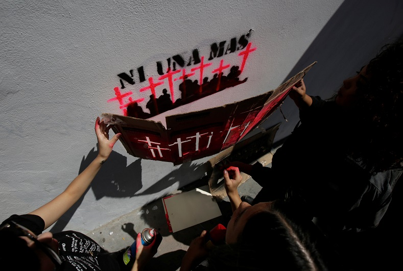"Demonstrators graffiti pink crosses with the words, ""Ni Una Mas."" There have been over 300 femicides in Mexico since 2016."