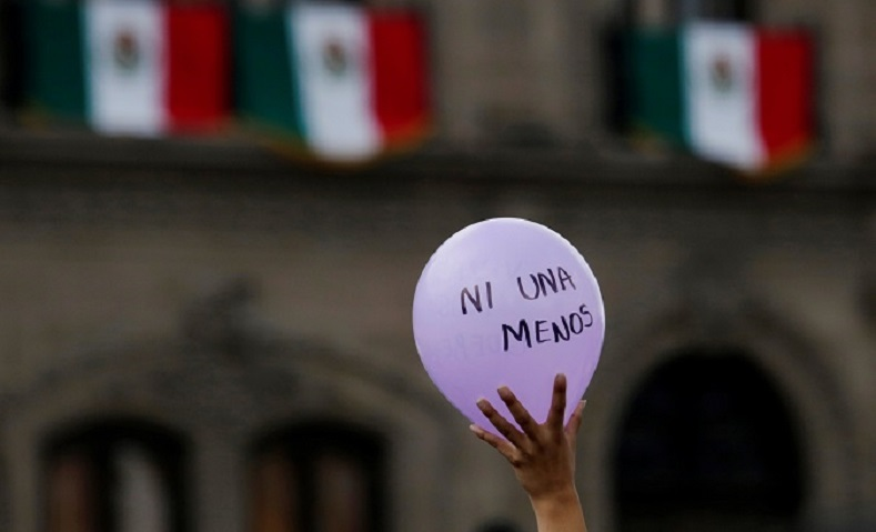 "A Protester carries a balloon which reads, ""Ni Una Mas"" or ""Not One More"" in a push for the Mexican government to intercede and end femicides."