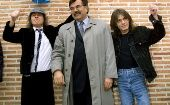 Angus and Malcolm (R) Young, founder members of AC/DC, flank the mayor of Leganes in Madrid following the inauguration of a new street with the group