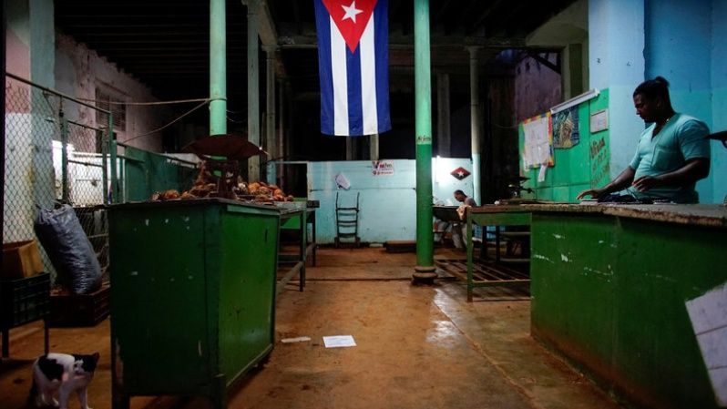 "A Cuban flag decorates a subsidised state store, or ""bodega"", where Cubans can buy basic products with a ration book they receive annually from the government, in downtown Havana, Cuba November 22, 2017. Picture taken November 22, 2017."