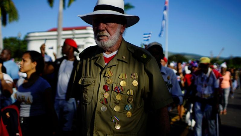 Revolution veteran Carmelo Saldivar, 82, is seen wearing his medals during a march to commemorate the first anniversary of interment of late Cuba
