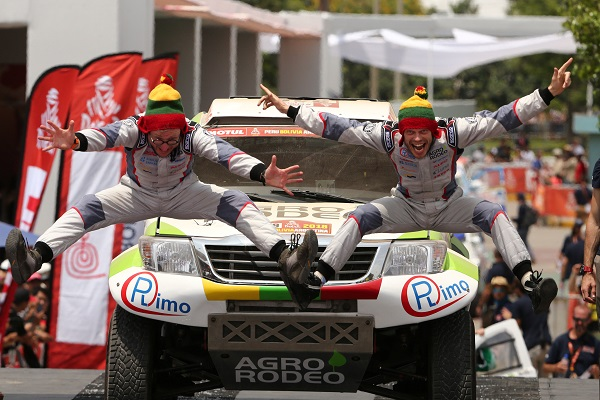 Agrorodeo Team driver Vaidotas Zala and co-driver Saulius Jurgelenas of Lithuania jump at the podium during the departure ceremony.