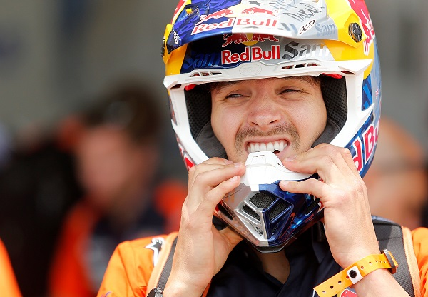 Red bull KTM factory team rider Sam Sunderland puts his helmet on after a technical check at Las Palmas air base in Lima.