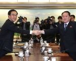 Head of the North Korean delegation, Ri Son Gwon shakes hands with his South Korean counterpart Cho Myoung-gyon during their meeting at the truce village, January 9, 2018.
