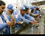 Bangladeshi migrant workers in Qatar's Industrial Area.