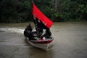 Rebels from Colombia's National Liberation Army in a boat in the northwestern jungles.
