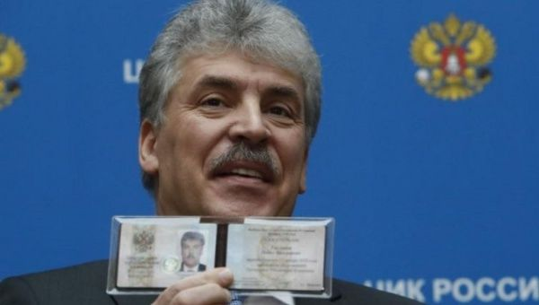Businessman Pavel Grudinin, representing the Russian Communist Party, demonstrates his identity document after he was registered as a presidential candidate.