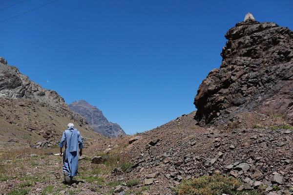 A priest walks up a hill at the Chilean and Argentinian border ahead of the Papal visit in Los Andes, Chile.