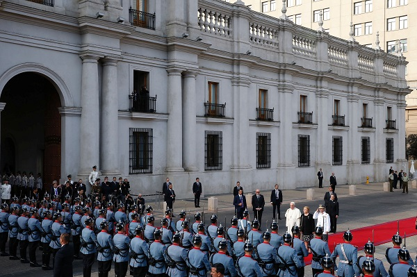 Pope Francis and Chilean President Michelle Bachelet review honour guards at La Moneda Presidential Palace during his visit in Santiago.