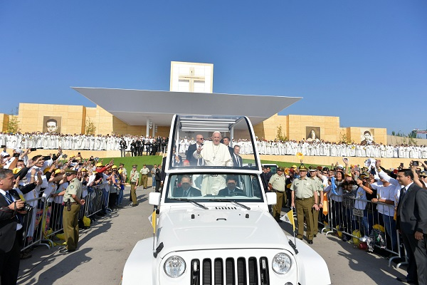 Pope Francis arrives to lead a mass at O