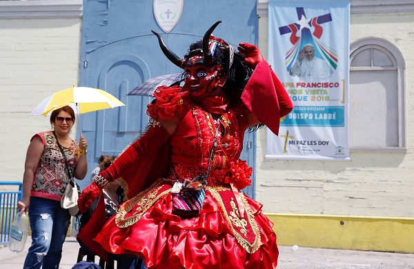 A dancer from the Diablada group performs a day before the arrival of Pope Francis in Iquique, Chile, January 17.
