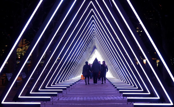 Visitors to the South Bank walk through The Wave, by Vertigo, one of several light installations placed around the capital which together form the Lumiere London festival.