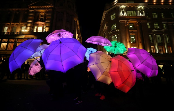 """The Umbrella Project"" by Cirque Bijou, from the UK, is seen lighting up the London night."