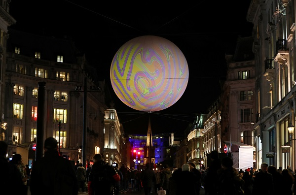 "Visitors at Oxford Circus view ""Origin of the World Bubble 2018,"" by Miguel Chevalier."