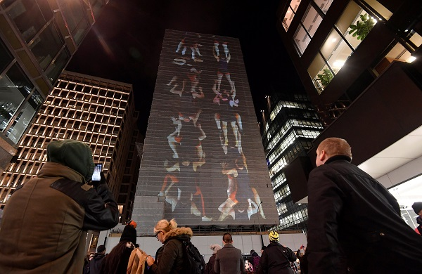 """Asalto London,"" by Spanish artist Daniel Canogar, is projected onto Westminster City Hall."