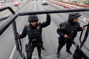 Members of the Fuerza Civil (Civil Force) police patrol during a media presentation in Monterrey, Mexico. Dec. 17, 2014.