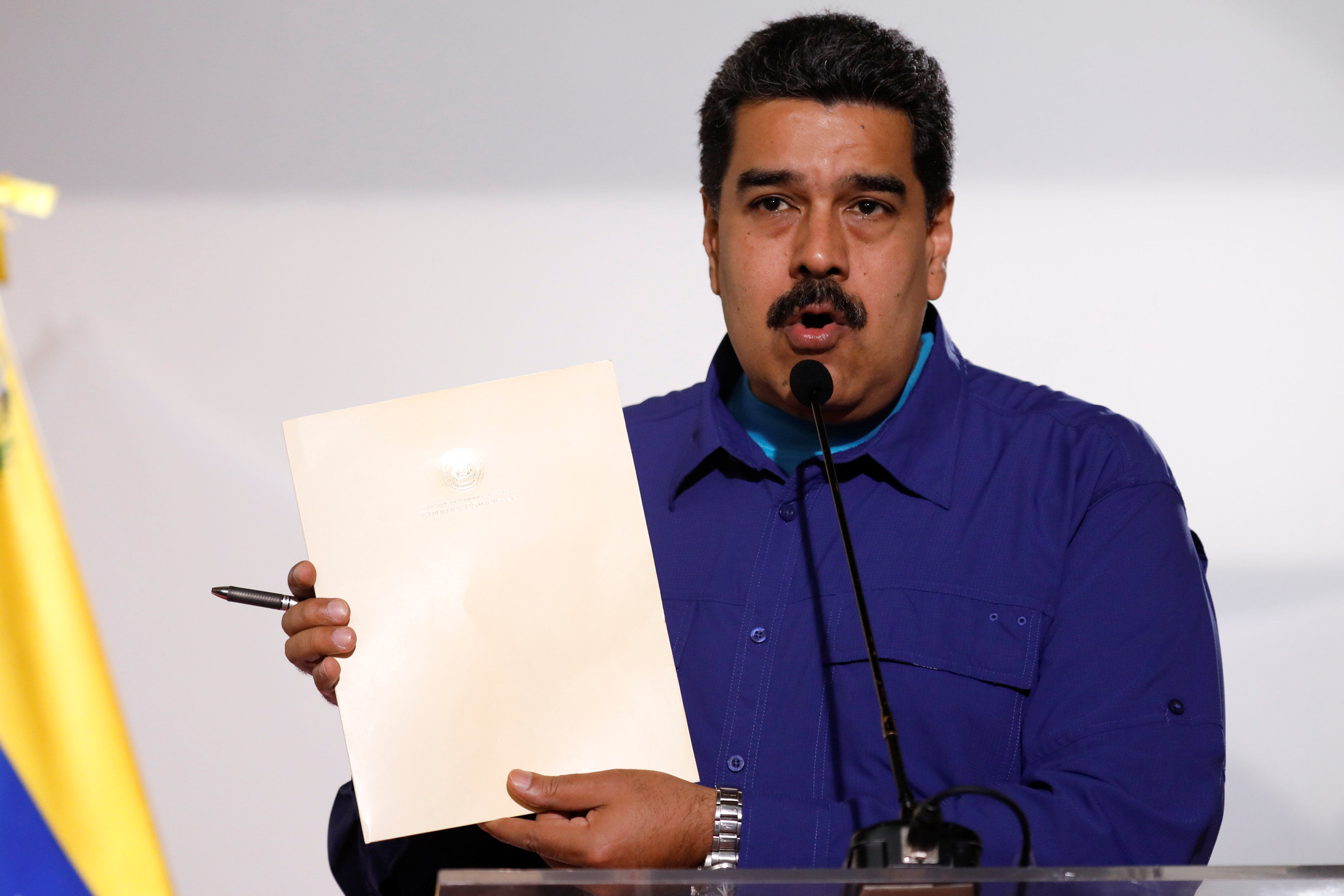 Venezuela's President Nicolas Maduro holds a document as he talks to the media before an event with supporters of Somos Venezuela (We are Venezuela) movement in Caracas, Venezuela February 7, 2018.
