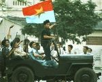 Communist North Vietnamese soldiers celebrate as they enter Saigon, triumphant, in 1975.