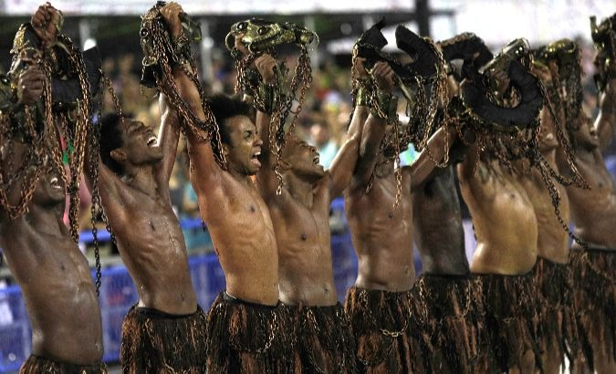 Revellers from Paraiso do Tuiuti Samba school perform in the city of Rio de Janeiro.