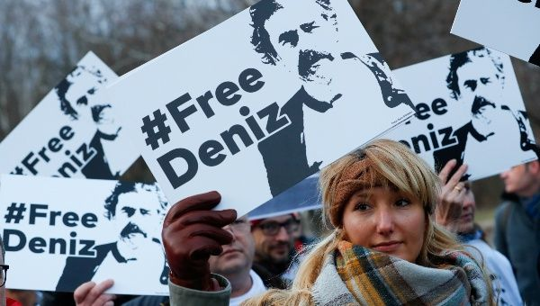 Protestors carry placards during a demonstration to support arrested German-Turkish journalist Deniz Yucel outside theTurkish Embassy in Berlin, Germany, February 28, 2017.