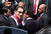 Peru's new President Martin Vizcarra waves to supporters after being sworn in at Congress in Lima, March 23, 2018.