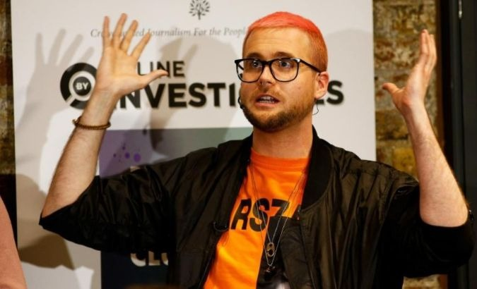 Christopher Wylie, a former Cambridge Analytica employee, speaks at the Frontline Club in London, Britain.