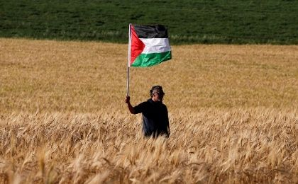A left-wing activist takes part in a protest in solidarity with Palestinians living in Gaza, next to the Gaza-Israel border.