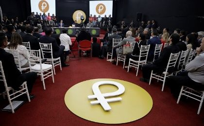 "The Venezuelan cryptocurrency ""Petro"" logo is seen as Venezuela"