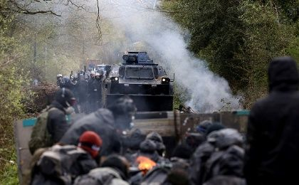Protesters gather as French gendarmes advance with an armoured vehicle during clashes during an evacuation operation in the zoned ZAD.