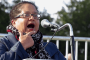 Marcela Howell, Executive Director of In Our Own Voice: National Black Women's Reproductive Justice Agenda, speak at the Women's March DC rally on Jan. 20, 2018.