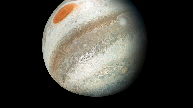 NASA's Juno spacecraft captured this color-enhanced image of Jupiter, around which the 'alien asteroid' orbits.