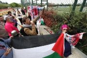 Palestinian rights supporters protest at Argentina's football training session in Barcelona, Spain.