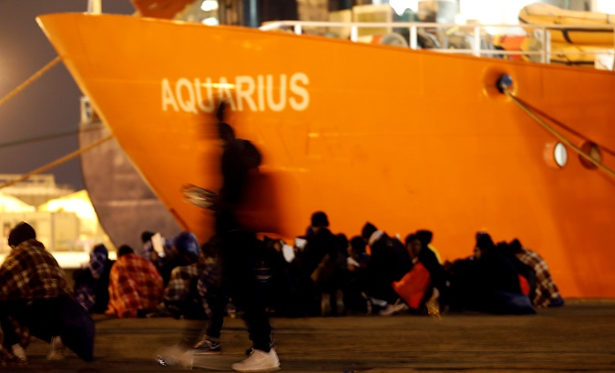 Migrants disembark from a search and rescue ship run in partnership between SOS Mediterranee and Medecins Sans Frontieres, on the island of Sicily, Italy.
