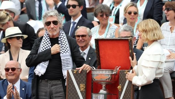 Singer Roger Waters with the trophy before the final between Spain